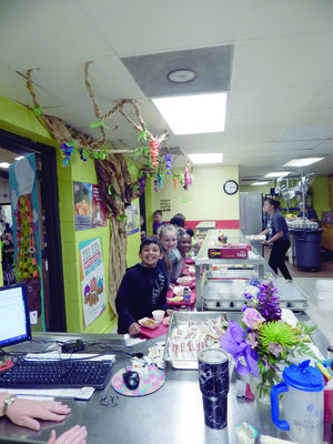 Photo by Josie Fox  Rusk Elementary School students are all smiles on barbecue sandwich day in the cafeteria.