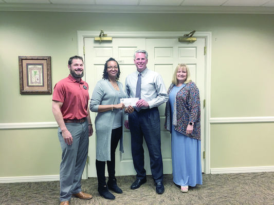 Courtesy Photo Austin Bank CRA Assistant Craig Scheler presents HOPE Executive Director Ellann Johnson with a donation from the bank recently. Also shown are Shawn Eyre and Debbie Braune.