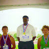 Courtesy photo Alto Yellowjacket Fred Thacker, center, wins the gold in State track and field events.