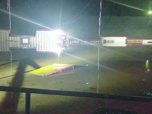 Flood waters submerge Harry's Building Material in Rusk Saturday night, when strong storms swept through the county.