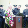 Photo by Josie Fox Jacksonville Mayor Randy Gorham, front, left, presents Jacksonville Police Chief Andrew Hawkes, front, right, with the Peace Officers Memorial Day and National Police Week proclamation during a ceremony held Wednesday, May 15 at Jacksonville City Hall.