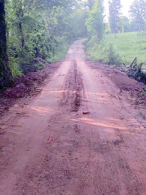 The same county road, after Precinct 1 road crews replaced the culvert and repaired the road surface over the last few weeks.