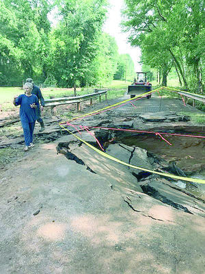 Cherokee County Precinct 2 crewmen did major repairs to a county road recently, after severe weather and flooding destroyed the road's surface and bridge