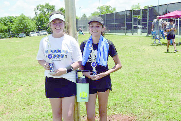 Photo courtesy of Sam Hopkins  Two Jacksonville girls finished first and second in the Tomato Fest tennis tournament Saturday, June 8, in the ages 14 and under division. Alena Trawick won first place and Sarah McCullough took second place.