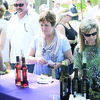 Courtesy photos Patrons and connoisseurs sample and purchase Texas-made wines during 2014's annual Piney Woods Wine Festival in Lindale.