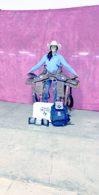 Davis shows off her prizes after earning the pole bending championship and All Around Cowgirl in the Texas High School Rodeo Association State Finals.