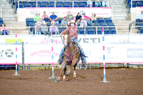 Courtesy photos  Alto's Reagan Davis navigates the pole bending course during the Texas High School Rodeo Association's State Finals, held recently in Abilene. Davis walked away from the competition with two state titles.