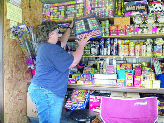 Photo by MIchelle Dillon Traci Norton, of T&K Fireworks on U.S. Highway 69 N next to the Cherokee County Electric Cooperative, is stocked and ready to celebrate Independence Day. See page A4 for an updated list of area July 4th events.