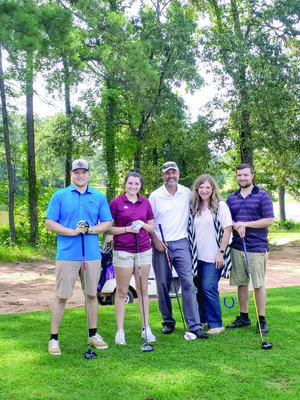The Raiborn team recently placed first in a Rusk Chamber of Commerce sponsored golf scramble held on Saturday, July 6. Pictured left to right are Josh, Lily, Mark, Angela and Jacob Raiborn. Mark and Angela have owned and managed Birmingham Golf Course for over 20 years.