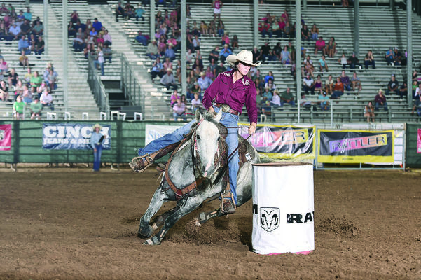 Reagan Davis of Alto cuts around a barrel during her 16.922 ride on Sunday. Davis is also participating in pole bending and breakaway roping events.