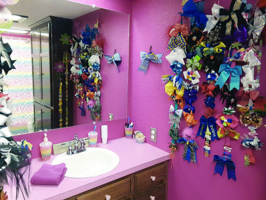Photos by Cristin Parker The Simmons' girls get their own hot pink bathroom and all the hair bows they can stand.