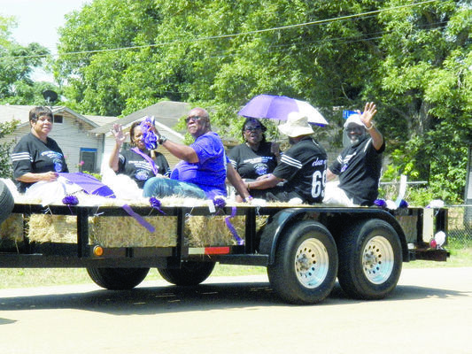 Alumni from the Fred Douglass High School class of 1969 waved at parade attendees during the festivities surrounding the 17th Fred Douglass alumni biennial reunion.