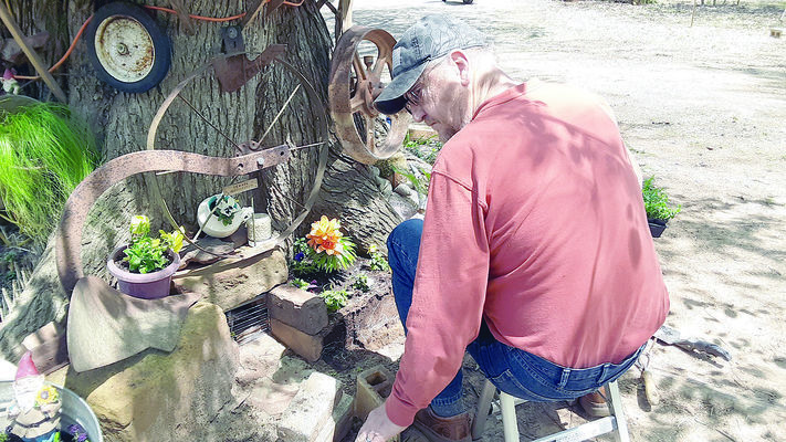 Courtesy Photo Jerry Burford works on a new addition to his ever growing tiny village.
