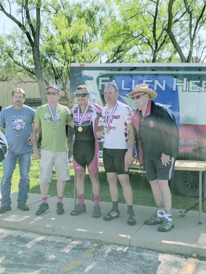 Lance Slack, gold medal winner of the time trial (center) at the Police Games in Abilene, poses with (from left) local event coordinator, Lt. Joe Tauer of Abilene, bronze medalist David Atkins of the Austin PD, silver medalist Jay Swann with Taylor County Sheriff's Office and state coordinator, retired San Antonio Sgt. Neal Mitchell.