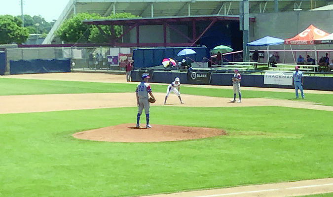 Photos by April Smith Bullard Panther Hagen Smith takes the mound as a member of the Texas Ranger Scout Team.