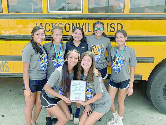 Courtesy Photo The Jacksonville Maidens varsity cross country team displays the hardware brought home from the 6A-5A Union Grove Invitational meet Saturday, Aug. 24.