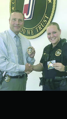 The Jacksonville Police Department would like to congratulate JPD Officer Jennifer Gillham, shown at right, on her recent promotion to corporal. Also shown is Jacksonville Police Chief Andrew Hawkes.