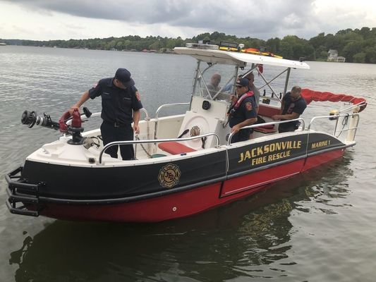 Members of the Jacksonville Fire Department train with the department's new fireboat on Lake Jacksonville.