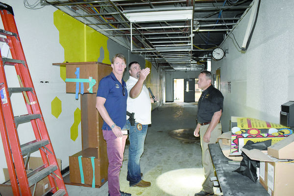 Alto ISD board member Jed Morris and Alto Police Chief Jeremy Jackson showed Josh Davis parts of the now unusable high school building. The building took significant damage during the bout of tornados that hit Alto on April. 13.