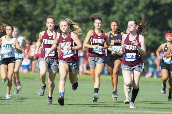 PHOTO BY ALAN LUCE Troup's Meredith Howell, Sarah Neel, Hadley Derrick and Valerie Guthrie run in the Tyler Lee Cross Country Classic held at UT Tyler Saturday, Sept. 7.