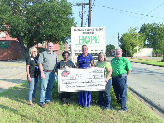 Photo by Jessica Payne Pictured from left, are Jacksonville Chamber President Peggy Renfro, Vance Royon, Janis Adams, HOPE Administrator Ellann Johnson, Pam Anderson and Dale Jamerson.  The group shows off the donation the Chamber recently presented to HOPE.