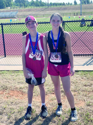 Courtesy photos Rusk runners Kaleb Baldwin, left, and Madelene Baldwin show off their hardware they won in the East Texas Invitational.