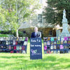 Courtesy photo Cherokee County Judge Chris Davis peruses the mobile exhibit currently set up on the courthouse lawn in Rusk. The exhibit highlights the state's domestic violence epidemic, as reported by the Crisis Center of Anderson and Cherokee Counties.