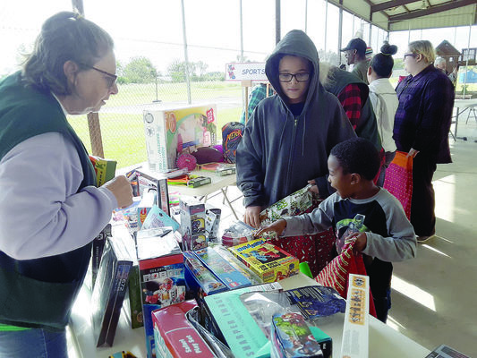 Photo by Cristin Parker  One Alto boy gets excited about his choices during the Convoy of Toys, brought to the city of Alto's youth by the Lone Star Santas last weekend. The event was held at The River Church for families affected by April's tornadoes.