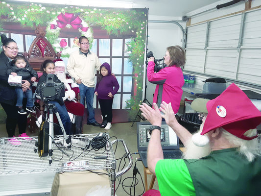 Photo by Cristin Parker Alto family of Melody Gomez, Michael Flores, Mialey Flores, Haraldo Flores and Lily Flores get a photo with The Santa, during Saturday's Lone Star Santas visit to Alto.