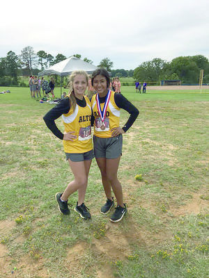 Kylee Powers (left) and Candy Castro of Alto High School participated in district cross country meet on Oct. 16. Castro finished in the top 10 and will advance to Region III Championships.