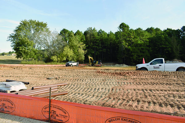 Photo by Josie Fox Crews can be seen working on the initial dirt  and foundation work for the O'Reilly's location in Rusk