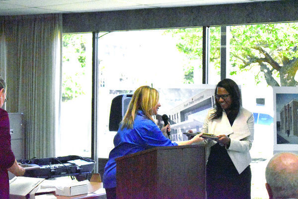 Rusk Mayor Angela Raiborn, left, presents a key to the city of Rusk to HHS Executive Commissioner Dr. Courtney N. Phillips.