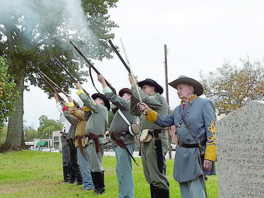 Sons of Confederate Veterans Cross of St. Andrew Camp of Cherokee County fire a rifle volley, honoring past and present veterans of all five U.S. military branches during the annual Veterans Day ceremony held Monday, Nov. 11, in downtown Rusk.