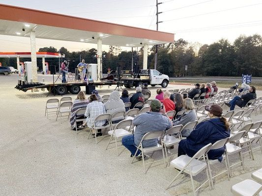 Community members enjoyed hamburgers and a concert by Ian Chandler to honor veterans during Truckerz Veterans Day celebration.