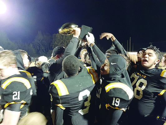 Photo by Michelle Dillon Alto High School Yellowjackets celebrate their perfect season after Friday's game.