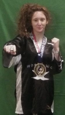 Photos courtesy of Wayne Chancellor State Karate Champion Cassie Wallace shows off her form and her championship ring and medal after winning her division in the 21st annual Martial Arts Expo and State finals last month.