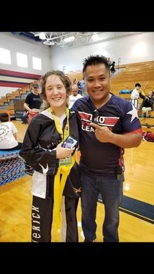 Alto ISD student Cassie Wallace poses for a photo with Texas Karate Organization (TKO) League World Champion Wayne Nguyen, founder of the TKO League.