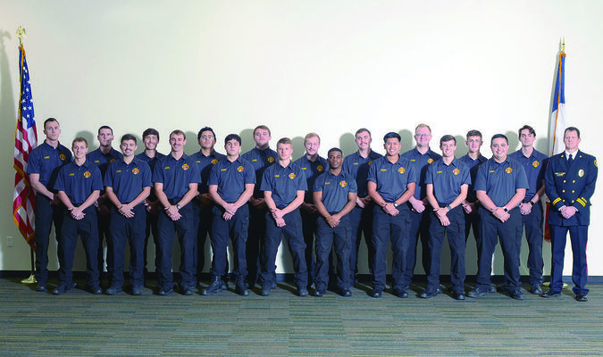 Photo credit: Tracy Delk  TJC Fire Academy graduates pictured front, from left are: Jonathan Surlet, salutatorian, Larue; Carson Davis, Celina; Logan Culp, Alba; Micah Meador, Tyler; Alec Tipton, Jacksonville; Tevarri Graves, Tyler; Jeremy Gallegos, Abilene; Kobey Roberts, Gun Barrel City; Justin Keele, Reno; Capt. Andy King, fire academy director; second row, Eric Meisner, Tyler; Dean York, Chandler; Lyn York, valedictorian, Chandler; Noe Yepez, Tyler; Dawson Smith, Prosper;  Mason Daniel, Murchison; Cody Watts, Emory; Colt Smith, Forney; Bryce Driver, Rusk; and Hayden Bradshaw, Chapel Hill.