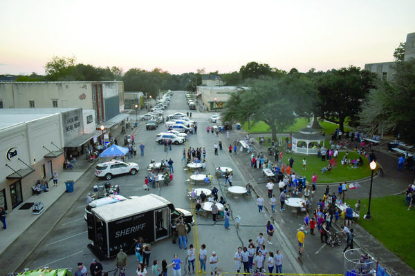File photo Citizens from all over Cherokee County enjoy burgers, games and more during a recent National Night Out event, held by Rusk Police Department.