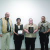 Courtesy Photo Pictured from left to right are Sheriff James Campbell, Sgt. Annette Gonzalez, Jailer of the Year; Merideth Bingham, Dispatcher of the Year;  and Cody Rodriguez, Law Enforcement Officer of the Year.