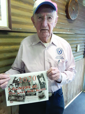 Shelley 'Shamrock' Cleaver shows off this year's historic pictorial calendar featuring Cherokee County lore.