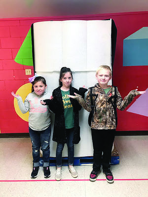 Photo by Ashley Oliver Rusk Elementary students wonder what's in the box.