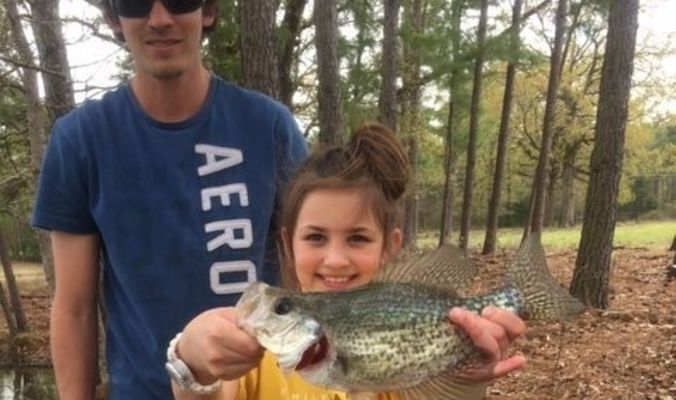 Photo courtesy of Rhonda Robinson  Kylie Robinson caught this nice Crappie recently while fishing with her dad, Wil Robinson and little sister, Serenity Robinson, at a private lake in Rusk.