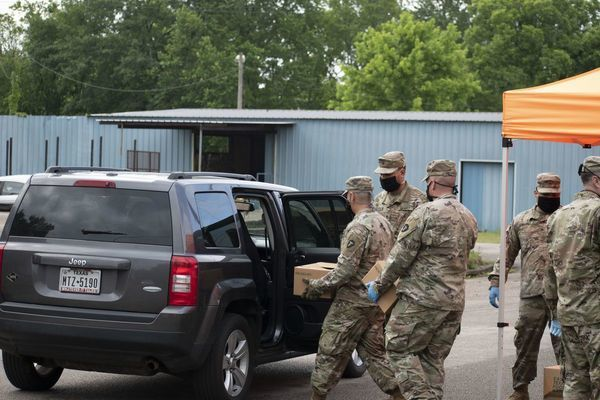 Photos by Josie Fox Members of the National Guard load up a vehicle with foodstuffs during a special all-inclusive food distribution event held Wednesday, May 13 at the Good Samaritan in Rusk, in conjunction with the East Texas Food Bank.