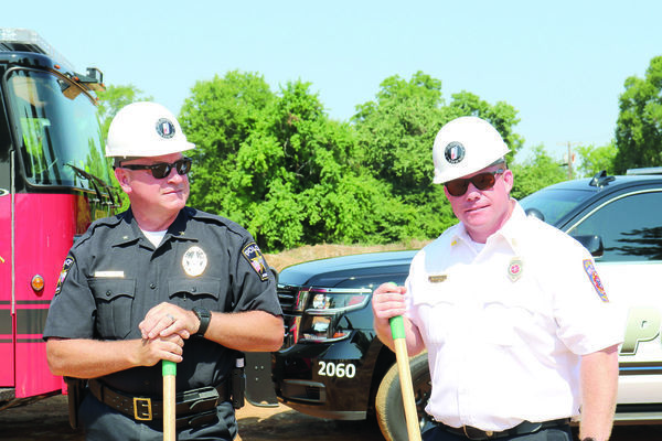 JPD Chief Joe Williams, left, and JFD Chief Keith Fortner get ready to officially kick off construction of a new facility for both their departments.