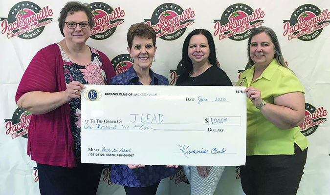 Courtesy photo Jacksonville Chamber of Commerce Education Division Chair Pam Anderson, far right, recently accepts a $1,000 donation from the Jacksonville Kiwanis Club for the Back 2 School project. Also pictured, from left, are Kiwanians Karen Nolley, Judy Batton and Tabatha Baker Ainsworth.