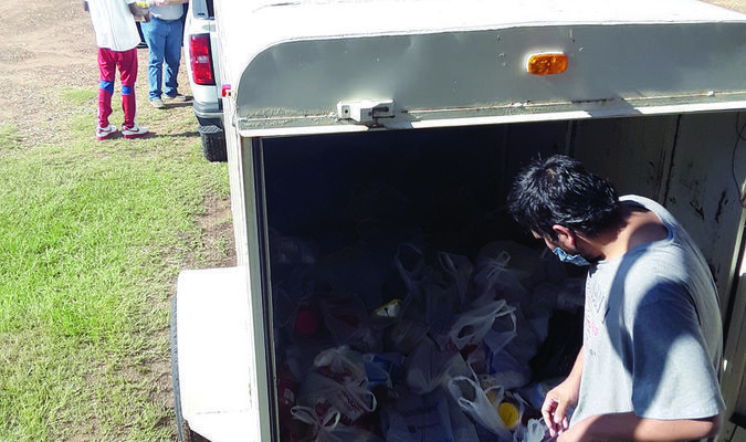 Photo by Cristin Parker Cherokee County Community  Supervision and Corrections Department staff and clients unload a trailer load of donated food items at the Good Samaritan in Rusk last week.