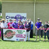 Courtesy photo Jacksonville Chamber of Commerce members celebrate the grand opening of Pam Anderson's new business, Compacity, with a ribbon cutting held Friday, July 17, on Kickapoo Street in Jacksonville.
