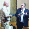 Photo by Cristin Parker County Judge Chris Davis wishes Sheriff James Campbell a fond farewell with gifts honoring his career as the longest serving sheriff in the county's history, during Tuesday's commissioners court meeting.