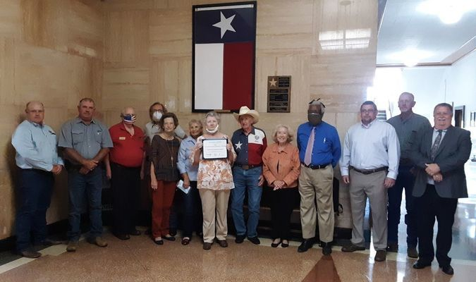 Photo by Cristin Parker Cherokee County Commissioners Court members pose with members of the Cherokee County Historical Commission at the courthouse in Rusk.